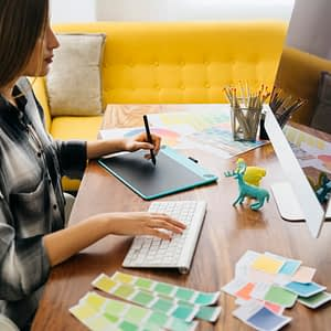 side-view-of-graphic-designer-at-desk_23-2147652919-circle